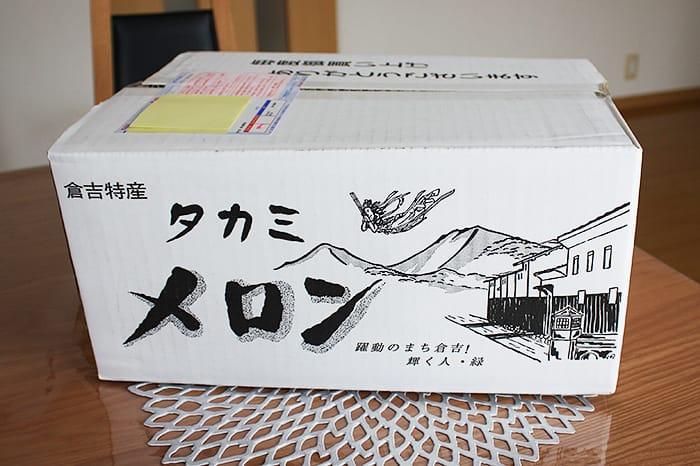 倉吉特産のタカミメロンの箱